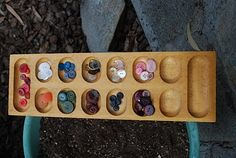 Sorting buttons or gems into a mancala tray
