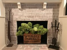 Whitewashed fireplace! I did it! (And grew those flowers, too!)