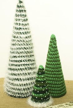 Insanely Fast and Easy Christmas Trees - @petalstopicots is always coming up with the cutest crochet patterns. These tabletop trees need very little yarn to work up and give you plenty of space to add other decor to the table.: