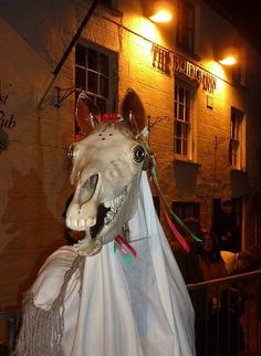 In the Welsh folkloric tradition of Mari Lwyd, a horse skull visits your home near Christmas, and you must best it in a challenge of rhymes. Horse Skull, Christmas Horses, Twelfth Night, Hobby Horse, Holy Mary, Green Man, Winter Solstice, Skull Art, Christmas Traditions
