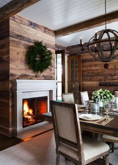 I love the contrast between the white beadboard ceiling, and the floor boards on the walls.  The white mantel brings it all together.  Cabin with a modern twist!