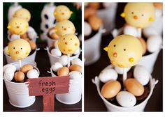 Chick cake pops surrounded by speckled candy eggs.