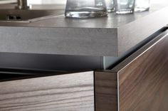 Burbidge's Otto Kitchen in Dark Walnut, Painted Mink and Concrete - Handleless Rail in Anthracite