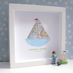 Inspiration Very sweet and unique map boat artwork with white background and contemporary white box frame with glass front. The hand crafted map itself can be personalized and the design can also be personalized with a chosen name or special message. By Sweet Dimple and available for purchase at Not on the High Street in the UK for 65 British pounds