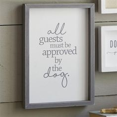 """All Guests Dog Plaque: Wooden plaque features raised wooden borders, printed sentiment """"all guests must be approved by the dog"""" and hangs with sawtooth hardware."""