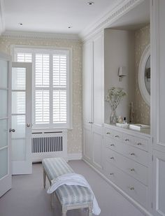 walk-in closet by Sims Hilditch.  Attention to details, including molding.