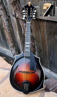 David Grisman's 2009 Giacomel J-3 custom mandolin (http://www.mandolincafe.com/news/publish/mandolins_001266.shtml)