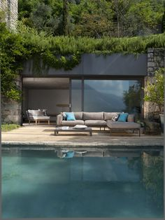 Love the color of this pool and the greenery on the roof. Beautiful architecture and landscaping.