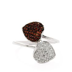 A stunning Ring from the Manhattan collection, made of Sterling Silver featuring 1/3ct of dazzling Red and White Diamonds from Africa.
