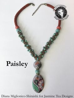No automatic alt text available. Beaded Jewelry, Beaded Necklace, Lampwork Beads, Washer Necklace, Diana, Turquoise Necklace, Paisley, Ideas, Beaded Collar