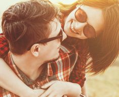Woman embraces a man, with sunlight effect stock photo