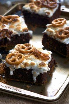 S'mores get an update with these Toasted Marshmallow Brownies as they are made healthier with oats, applesauce, two types of chocolate and then sit on top of cinnamon sugar pretzels!