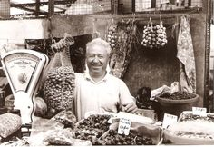 Nice b & w shot of a cheerful vendor at Tavira Market, Portugal 1998.