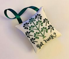 Excited to share this item from my #etsy shop: St. Patrick's gift, shamrock, cross stitch ornament, St. Patrick's decoration, good luck, clovers, green, primitive, good bye gift, finished St Patrick's Cross, Clover Green, Clovers, Dmc Floss, Pin Cushions, Light In The Dark, Primitive, Stitching, Great Gifts
