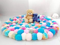 READY TO SHIP BEAUTIFUL HANDMADE POM POM CIRCLE SHAPE RUG IDEAL FOR A LITTLE PRINCESSES BEDROOM! ON TREND UNICORN COLOURS APPROX DIMENSIONS - 85-90 CIRCUMFERENCE THIS STUNNING CIRCLE SHAPED RUG HAS BEEN LOVINGLY MADE FROM APPROX 215 HANDMADE YARN POM POMS. THEY ARE ATTACHED TO A LATCH HOOK BASE AND ARE PULLED THROUGH TWICE AND KNOTTED TO MAKE THE POM POMS MORE SECURE. SO TACTILE & COZY - THIS RUG WOULD LOOK STUNNING IN A CHILDS BEDROOM, PLAYROOM OR NURSERY. NON SLIP GRIP COULD BE A...