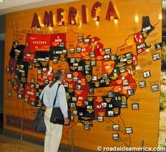 Roadside Attraction Map Art With Tourist Snapshots Covers Maps On Two Corridor Walls At Denver International Airport