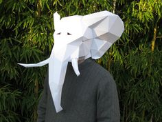 Make your own elephant mask from paper, card stock, or cardboard with this PDF template! Paint the finished mask however you like to create your