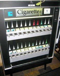 Cigarette machine.  Banned becase minors could use them to get cigarettes.