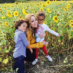 Doting mom: Mariah Carey celebrated the season by enjoying 'autumn moments' with her four-year-old twins Moroccan (L) and Monroe (R), which she documented to Instagram on Tuesday