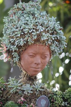 Pottery Face - Garden Living, this is very unique.