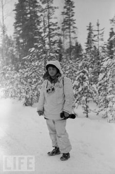 American photojournalist Carl Mydans (1907 - 2004), on an assignment from LIFE magazine to cover the Winter War Finland, 1940.