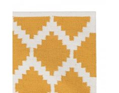 Layer your home with striking pattern with the Indian made Satara Rug. Plain woven on a hand-loom from 100% cotton, the beautifully textured Satara boasts a bold, two-toned geometric motif that will create the statement you want in all modern living spaces. This ethically made, reversible design is finished with a plain border along the edges. Also available as a runner.