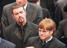 Pop stars George Michael (top) and Elton John leave Westminster Abbey after the funeral service of Diana Princess of Wales in 1997 - they were both very close to the Royal