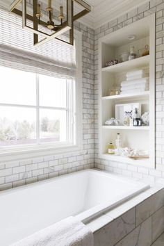 ----------------------------- Original Pin Caption: Bathtub nook completed with a built-in shelf surrounding Calcutta gold marble tiles. Bathroom Renos, Bathroom Renovations, Bathroom Furniture, Home Remodeling, Bathroom Tubs, Bathroom Ideas, Master Bathroom Tub, Small Bathroom Cabinets, Bathroom Blinds