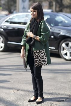 Street Style at Paris Fashion Week Fall 2013 | Miroslava Duma gave skinny bottoms a bold complement with an emerald-hued and leopard-print leather topper