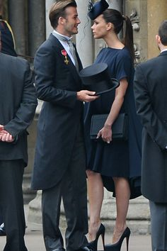 Posh (+ Becks, for good measure) showing how it's done in the 3rd trimester