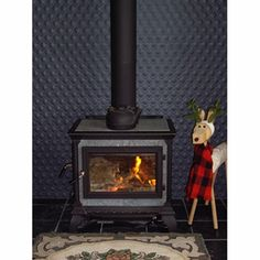 Tin Ceilings by Ashton Clarke Pressed Metal Design Fireplace Wall, Living Room With Fireplace, Fireplace Design, Fireplace Backsplash, Wood Burning Logs, Wood Stove Surround, Renovation Hardware, Pressed Metal, Home