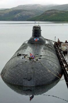 The biggest submarine in the world, the Russian Typhoon class SSBN. It has a sma. The biggest submarine in the world, the Russian Typhoon class SSBN. It has a small swimming pool inside it! Go ahead Military Weapons, Military Aircraft, Russian Submarine, Nuclear Submarine, Navy Ships, Military Equipment, Submarines, Aircraft Carrier, War Machine