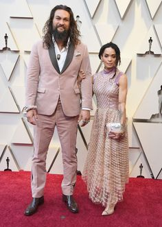 d6dea07f061 Black red carpet heels and dress. See more. Jason Momoa rocks a pink velvet  tux to the Oscars with Lisa Bonet   Finally