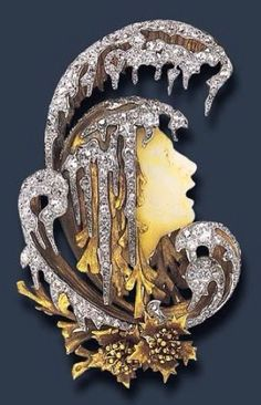 Art Nouveau 'Orpheus' carved hardstone brooch by Gabriel Falguieres, France, ca.1901. Depicts Orpheus as he floats down the river Hades, with diamond and gold stylized wave, and two gold floral motifs, mounted in gold