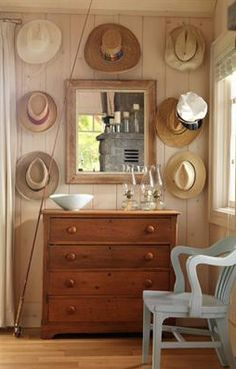 The gallery of hats creates a casual look in this space.