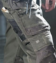 Tactical clothing is an integral part of any law enforcement agency's overall uniform. Mens Work Pants, Cargo Pants Men, Work Trousers, Tactical Wear, Tactical Pants, Tactical Clothing, Safety Workwear, Workwear Trousers, Outdoor Outfit