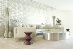 Love all the shiny surfaces in this modern living room