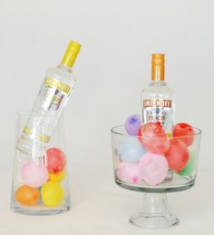 Freeze water balloons to keep your beverages cold and add a pop of color to your reception #wedding #reception #balloons #bar