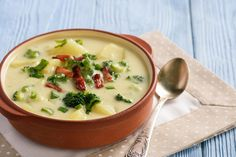 Vegan potato broccolI soup in a red soup bowl on a tan place mat with a spoon on the near right. Broccoli Soup, Broccoli Cheddar, Cozy Meals, Lentil Stew, Mug Recipes, Tailgating Recipes, Bacon, Chorizo, Healthy Eating