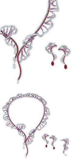 A SUITE OF DIAMOND, COLOURED SAPPHIRES AND RUBY 'CLÉO' JEWELLERY, BY BOUCHERON: Comprising a flexible torque necklace, designed as a line of circular-cut rubies, to the diamond fringe enhanced by circular-cut pink sapphire connections, each terminal suspending a pear-shaped diamond, one 2.39 cts, surmounted by diamonds, a pair of similarly-set ear pendants, each suspending a detachable oval-shaped ruby, 2.34 and 2.12 cts, in Boucheron purple cases. Via Christie's.