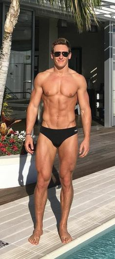 He looks good in those black trunks........