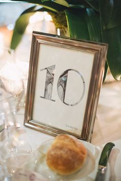 """Old New York"" Art Deco Themed Wedding; Table Numbers by 43DPI Creative Double exposure images of New York City landmarks; Central Park Loeb Boathouse; Alexandra Meseke Photography"