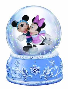 """Gliding along, feeling the rush of wind between their ears, mickey and minnie spend a lovely winter afternoon upon the """"ice"""" inside this 100mm musical water globe. Plays """"Vivaldi's winter."""