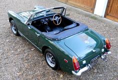 MG Midget (1972) in British Racing Green. Mine was a 1976. I sure do miss that little car. Named Penelope.