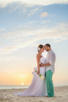 Bride and groom photographed on the beach at their destination wedding. Their whole wedding was beautiful!