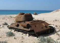 American Sherman Tank from the Second World War, buried into the sand of a beach.