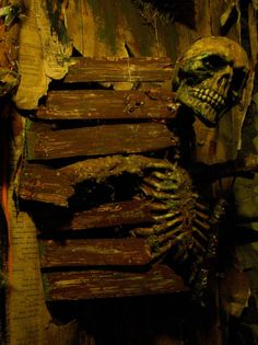 Fake wall slats with skeleton wallbreaker.   http://www.halloweenforum.com/members/theundeadofnight.html  http://theundeadofnight.wix.com/theundeadofnight