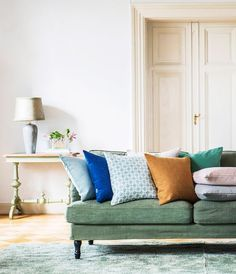 Colour popping | chic living room with panelled doors | Green sofa | IKEA Stocksund sofa with a Romo x Bemz cover | abundance of scatter cushions in eclectic hues
