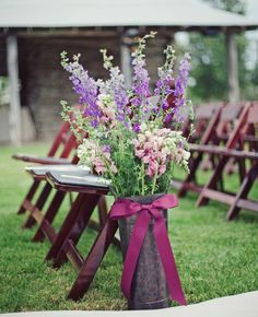 Galvanized Buckets used to hold flowers at the end of the ceremony aisle? Perfection.