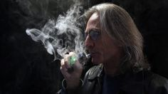 Additional effects of smoking  John Hartigan, proprietor of Vapeology LA, a store selling electronic cigarettes and related items, takes a puff from an electronic cigarett...